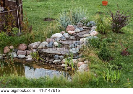 Landscape With Garden Pond With Plants In Countryside. Architecture Of The Countryside.