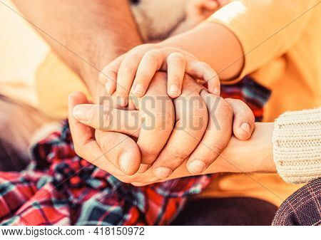 Hands Of Father, Mother, Keep Hand Little Baby. Parents Hold The Baby Hands. Closeup Of Baby Hand In