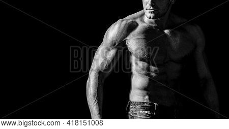Muscular Model Sports Young Man On Dark Background. Muscular Torso Close Up. Muscular Sexy Man With