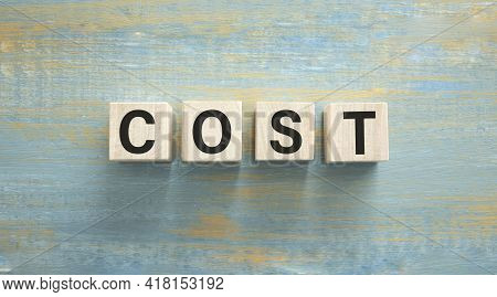 Costs Word Written On Wood Block. Costs Text On Cement Table For Your Desing, Concept.