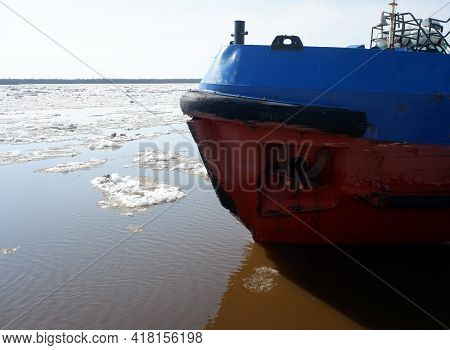 The Bow Of The Tug On The Big Spring River During The Ice Drift. Sunny Day, Blue Sky.