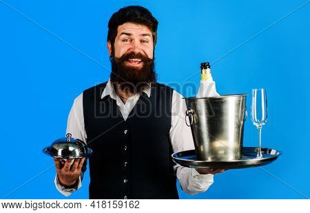 Professional Waiter In Uniform With Serving Tray And Wine Cooler. Restaurant Serving.