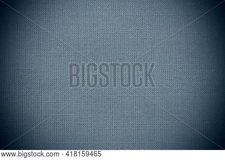 Texture Of Natural Blue Fabric Close-up. The Texture Of The Fabric Is Made Of Natural Cotton Or Line