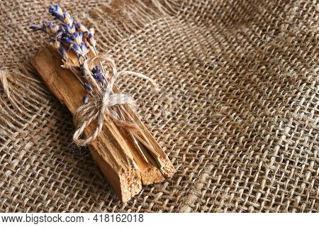 A Top View Image Of Palo Santo With Dried Lavender On A Burlap Background.