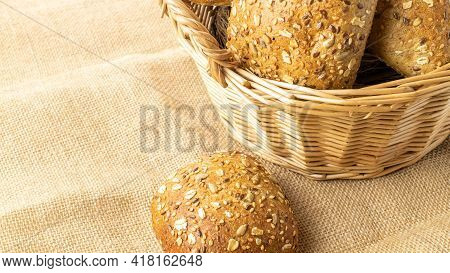 Cut Bread. Fresh Loaf Of Rustic Traditional Bread With Wheat Grain Ear Or Spike Plant On Linen Textu