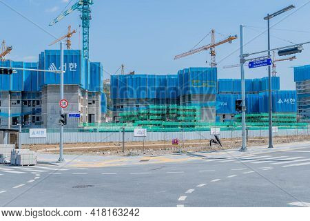 Daejeon, South Korea; April 18, 2021: Landscape Of Construction Site With New Apartment Blocks Being