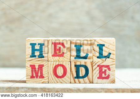 Alphabet Letter Block In Word Hell Mode On Wood Background