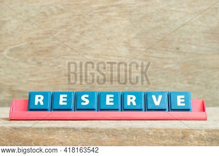 Tile Alphabet Letter With Word Reserve In Red Color Rack On Wood Background