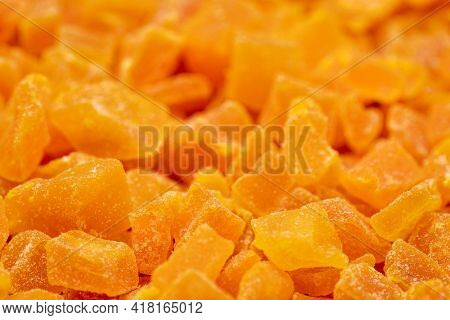 background and texture of dried mango fruit diced, selective focus