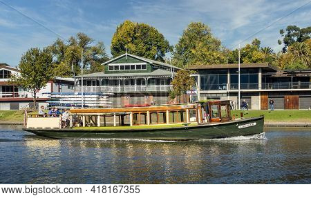 Melbourne, Australia - May 17, 2019: Public Park With Buildings In The Back. Sightseeing Boat Called