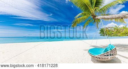 Tropical Beach Paradise As Summer Landscape With Beach Swing Or Hammock And White Sand, Calm Sea For
