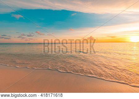 Closeup Of Sand On Beach Waves, Foam Surf Calmness Under Blue Summer Sky. Panoramic Beach Landscape.