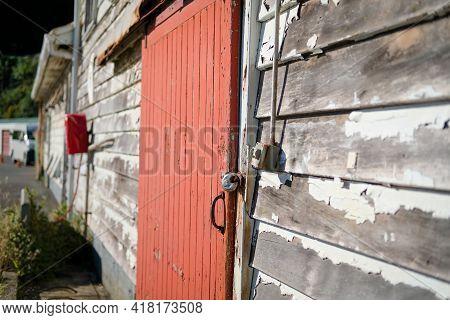 Delapidated Building With Red Door Needs Some Repair