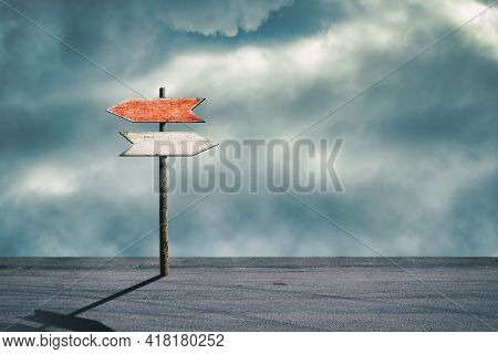 Wooden Sign With Arrows Pointing In Different Directions. Path Selection Concept. Making The Right D