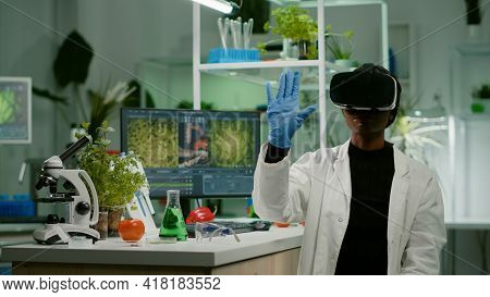 African Biologist Researcher With Virtual Reality Headset Researching New Genetic Experiment