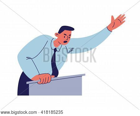 Furious Speech Of The Figure Behind The Podium. A Man In A Blue Shirt With A Tie Waves His Hand In E