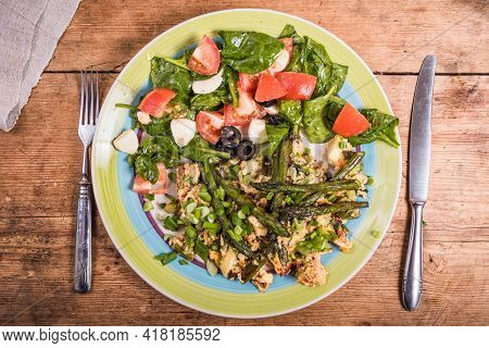 Fried Scrambled Eggs With Asparagus, Spinach And Tomatoes In A Large Plate On A Rustic Wooden Table,