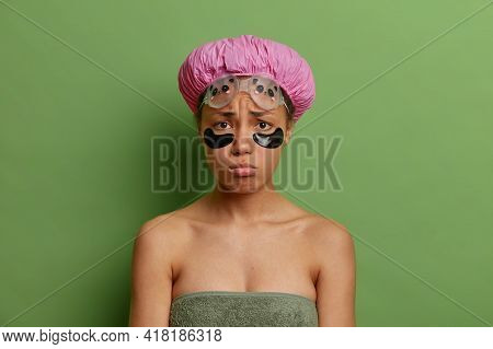 Sad Unhappy Young Afro American Woman Has Sulking Face Expression Applies Beauty Patches Under Eyes