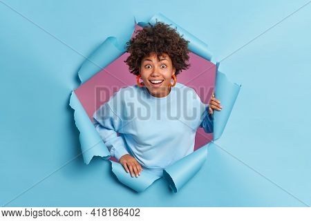 Happy Surprised Afro American Teenage Girl Reacts On Something Awesome Smiles Broadly Poses In Torn