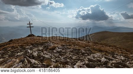 Patriarchal Cross On A Mountain Top With Spectacular Sun Rays Through The Clouds. Low Tatras (nizke
