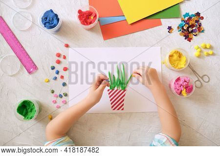Child Making Homemade Greeting Card. Little Girl Making Vase With Flowers From Paper And Clay, Plast
