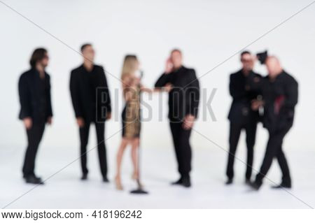 Blurred Portrait Of Diverse People Group On White Background.