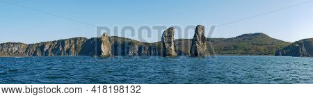 Exit On A Yacht To The Avacha Bay Of The Pacific Ocean. Panorama View Of The Rocks Three Brothers Ar