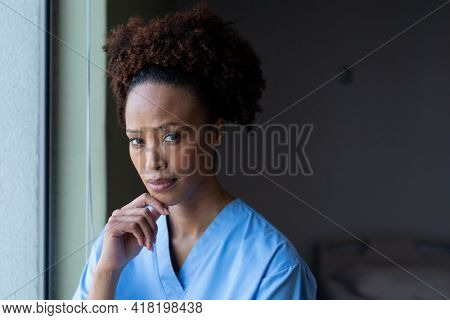 Portrait of african american female doctor in hospital patient room looking to camera. medicine, health and healthcare services.