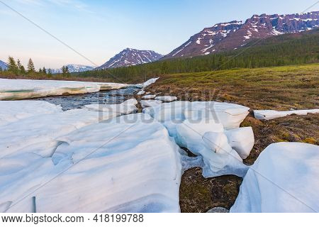 Snow And Ice On The Banks Of The River Hoisey. Putorana Plateau, Russia