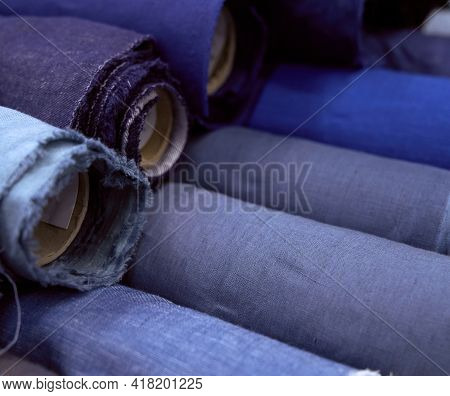 Close-up Textile Rolls In Gray And Blue Colors. Online Sale Or Sewing Objects Concept. Fabrics Retai