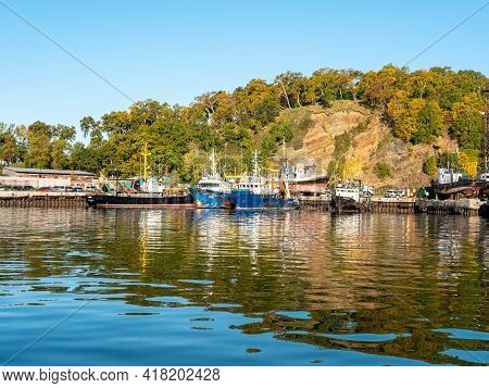 The Seaport In The Avacha Bay Of Petropavlovsk-kamchatsky. Old Ships Stand Near The Pier Against The