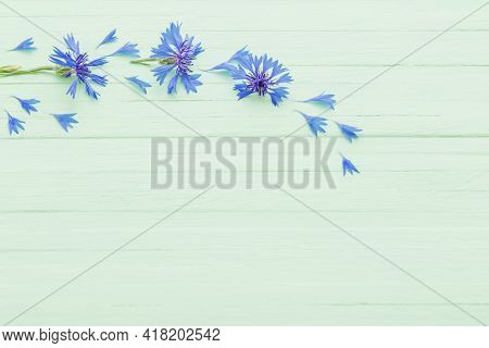 The Beautiful Blue Cornflowers On Wooden Background