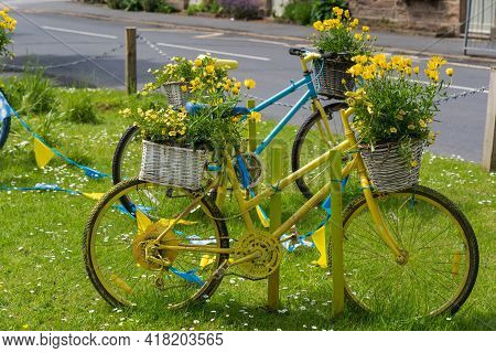 Blue And Yellow Bicycles With Baskets Full Of Yellow Flowers To Celebrate The Tour De Yorkshire Cycl