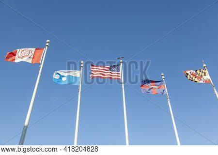 Five Flags Waving On A Windy Day In Ocean City Beach. They Represent Fire And Rescue, Ocean City, Ma