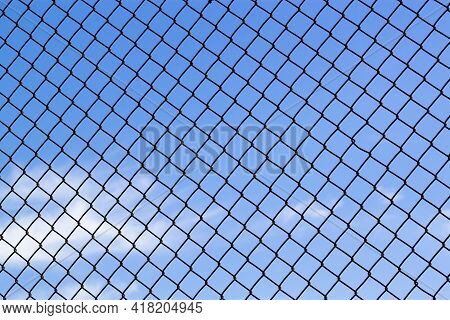 Abstract Image Showing A Latticework Of A Chain Fence Covering The Entire Blue Sky. Versatile For Co