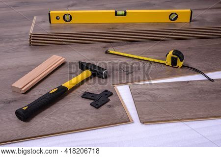 Equipment Or Tools To Install Laminate Floor, Hammer, Mallet, Spacers, Spirit Level Tool And Metre.