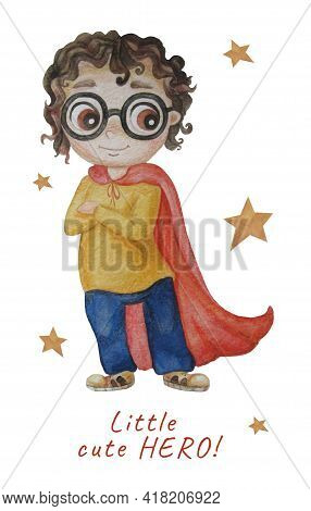 Little Cute Hero. Bright Cute Super Boy With Glasses And Curly Hair In A Red Long Cloak. Stands, Arm