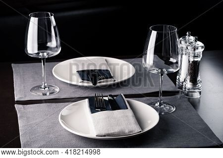 Elegant Table Setting White Plates On Black Wooden Table