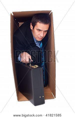 Businessman Inside Of A Cardboard Box