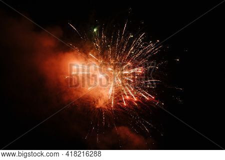 Bright Fireworks Explode In The Night Sky