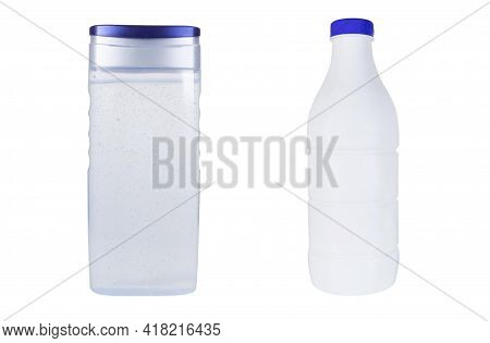 Two Plastic Bottles On An Isolated White Background. Clear Plastic Bottle And White Plastic Bottle W