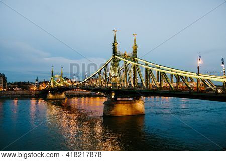 View Of The Liberty Bridge In Budapest With Night Illumination