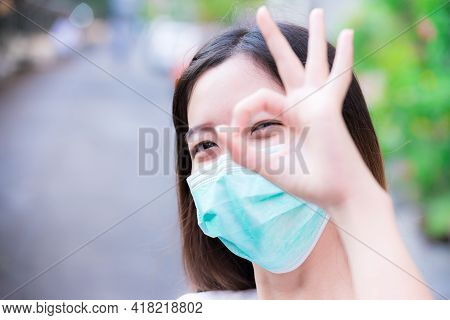 Prevent Spread Of Coronavirus And Pm2.5 Toxic Dust, Air Pollution Problem. Head Shot Of Woman Wearin