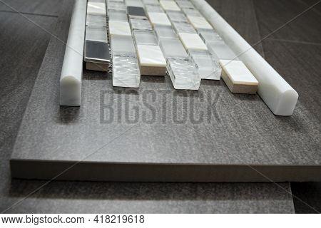 Mosaic Tile And Bullnose Trim Atop Porcelain Floor Tile
