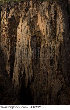 Long Cliffs Of Black Canyon Of The Gunnison With Morning Light
