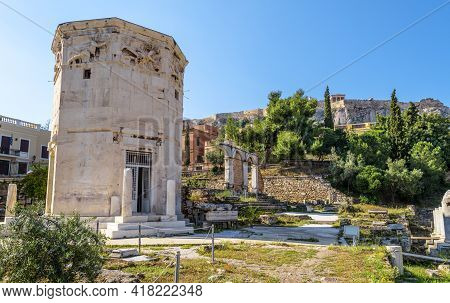 Roman Agora In Athens, Greece. Old Tower Of Winds On Left And Acropolis, Famous Landmark Of Athens I