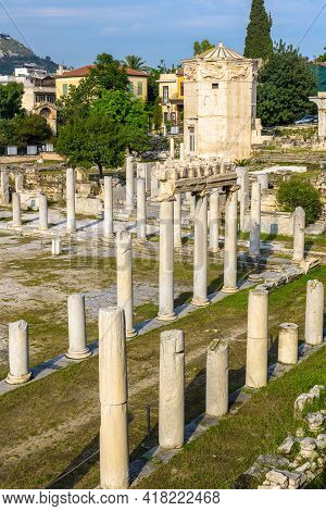 Roman Agora In Athens, Greece, Europe. Tower Of Winds Or Aerides, Landmark Of Athens In Distance. Ve