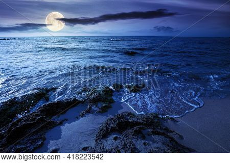 Seascape On A Sunny Morning At Night. Summer Vacation At The Sea In Full Moon Light. Yellow Sand On