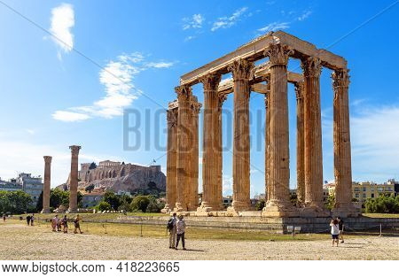 Athens - May 9, 2018: People Visit Temple Of Olympian Zeus, Athens, Greece, Europe. Famous Acropolis