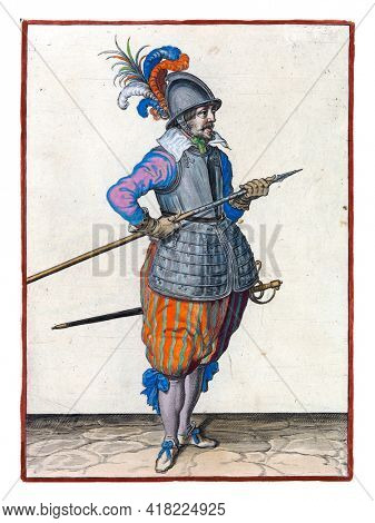 A soldier, full-length, to the right, carrying his spear (lance) with both hands by his right side, the point tilted upwards and close to his belly